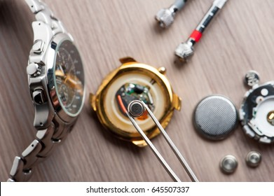 watch battery replacement, watchmaker replacing watch battery on quartz watch