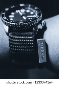 """A watch and a bracelet that features a bead that says, """"Indivisible."""""""