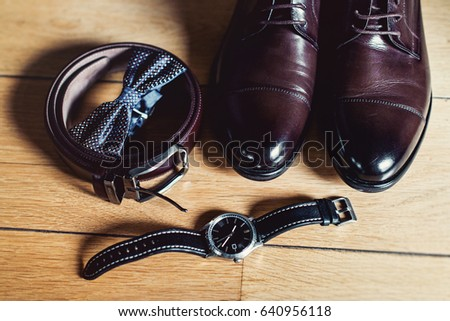 eaa14771c31b watch, Brown bow tie, leather shoes and belt. Grooms wedding morning. Close
