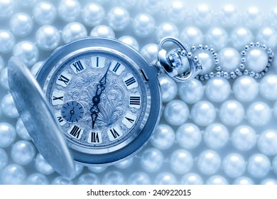 Watch in closeup on pearl background in cold colour