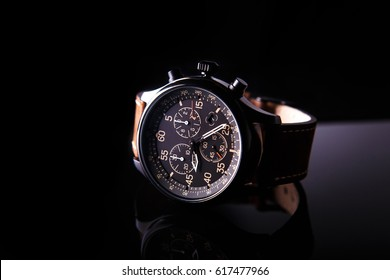 watch expedition arrow with brown leather strap on a black background