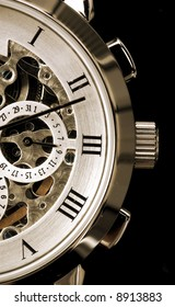 Gentleman's watch, with exposed mechanism showing wheels and cogs
