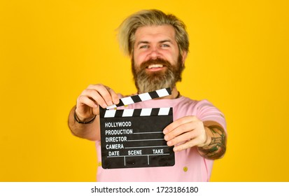 Watch movie. Film director. Actor casting. Shooting scene. Favorite series. Cinema production. Creative producer. Bearded man hold movie clapper. Film maker. Clapperboard copy space. Comedy or drama.