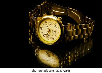 watch in a narrow beam of light on dark background