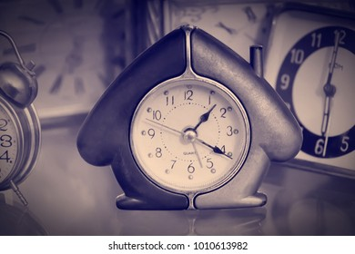 watch on the glass surface reflection in the form of a cozy cabin zanimi background other watches of different styles and shapes