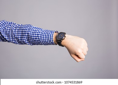 Watch on wrist isolated over a gray background