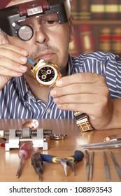Watch repair craftsman repairing watch. Focus on watch