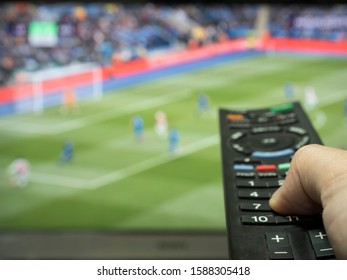 Watch a soccer game on TV while zapping.
