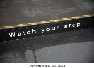 watch your step sign on road side