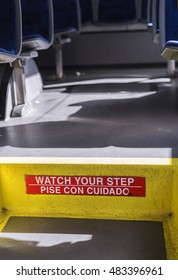watch your step warning on empty bus, low angle view.