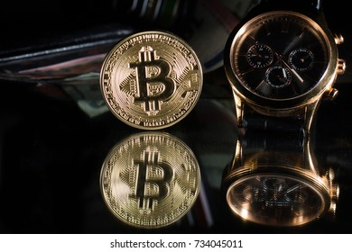 Watches with bitcoin close up on black background