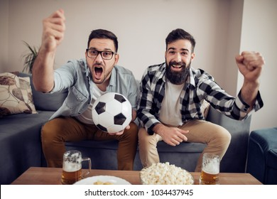 Watching the big game!Sport,people, leisure, friendship and  happiness concept.