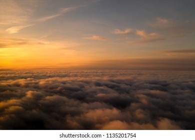 Watching the clouds from above from an airplane