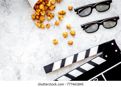 Watching film in the cinema. Clapperboard, glasses and popcorn o