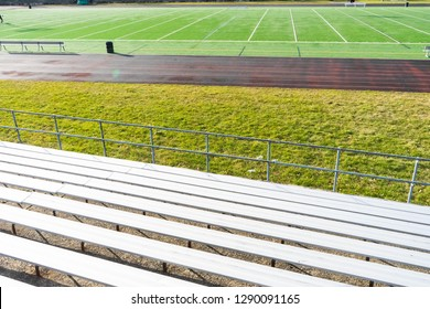 Watching the game from the bleachers with a huge football field ahead