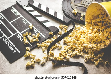 watching movie with popcorn on gray background close up