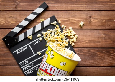 watching movie with popcorn on wooden background top view
