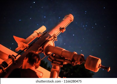 watching the night skywith telescope refractor
