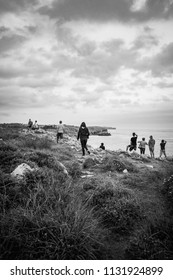 Watching the sunset from the cliffs of Asturias, Spain. Cantabrian sea. Black and white photo.