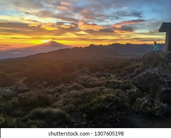 Watching sunset from high upon Mount Kilimanjaro with Mount Meru in the distance