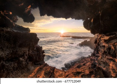 Watching the Sunset through the wonderful Ana Kakenga Cave on Rapa Nui, Isla de Pasca, Easter Island, Chile