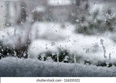 Watching through at a snow-covered window