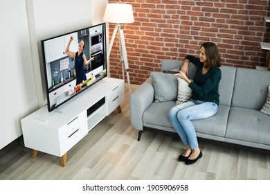 Watching TV Movie Sitting On Sofa In House