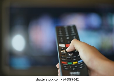 Watching TV and using remote controller.