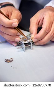 watchmaker fixing the watch movement