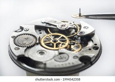 Watchmaker repair mechanical watches. Gears repair. Watch repair process