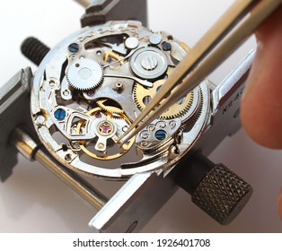 watchmaker repairing classic mechanical watch movement
