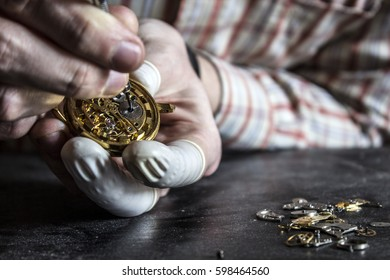 The watchmaker is repairing the mechanical watch