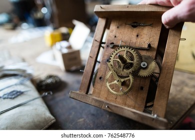 The watchmaker is repairing the mechanical watches, gear. Engineer working place