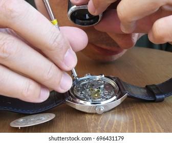 watchmaker repairing a vintage watch