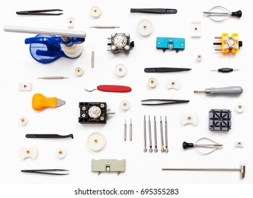 watchmaker workshop - ornament from various watch repairing tools on white background