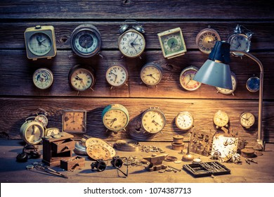 Watchmaker's workshop with many clocks, tools and spare parts