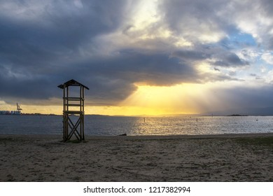 Watchtower of Compostela beach at stormy sunset in Vilagarcia de Arousa