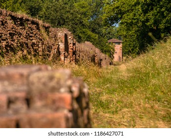 Watchtower and medieval city wall surrounding the town of Ferrara, Italy