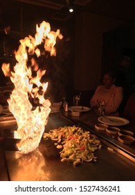 Watchung, NJ, USA April 22, 2018 A teppanyaki chef lights up the grill as part of his presentation at a Hibachi restaurant in Watchung, New Jersey