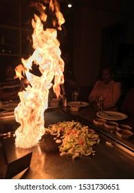 Watchung, NJ, USA April 22, 2018 A flame rises from a teppanyaki grill at a Japanese hibachi restaurant in Watchung, New Jersey