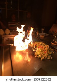 Watchung, NJ, USA April 22, 2018 Flames rise from a hibachi grill in Watchung, New Jersey as a teppanyaki chef performs the volcano trick