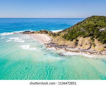 Wategoes Beach at Byron Bay from an aerial view with blue water in Australia