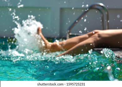 Water active leisure. Pool at the hotel. Feet in clear water flounder. Soft focus. Blur frame.