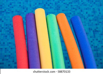 water aerobic equipment. colored aqua noodles in water