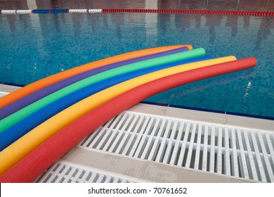water aerobic equipment. colored aqua noodles in swimming pool