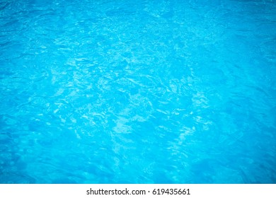 Water and air bubbles over blue background.