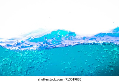 Water and air bubbles over white background,Blue sea waves.