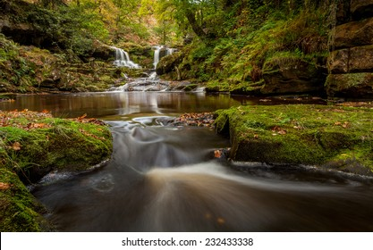 Water Arc Foss water fall in the North York Moors national park during Autumn.