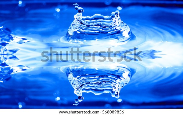 water background / Water is a polar inorganic compound that is at room temperature a tasteless and odorless liquid, nearly colorless with a hint of blue.