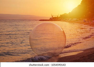 water ball on the sunset beach at summer
